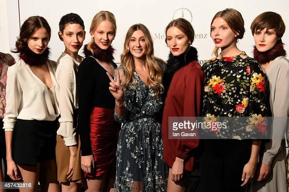 Fashion Designer Seyma Subasi poses with models backstage prior the Seyma Subasi presentation during Mercedes Benz Fashion Week Istanbul SS15 at...