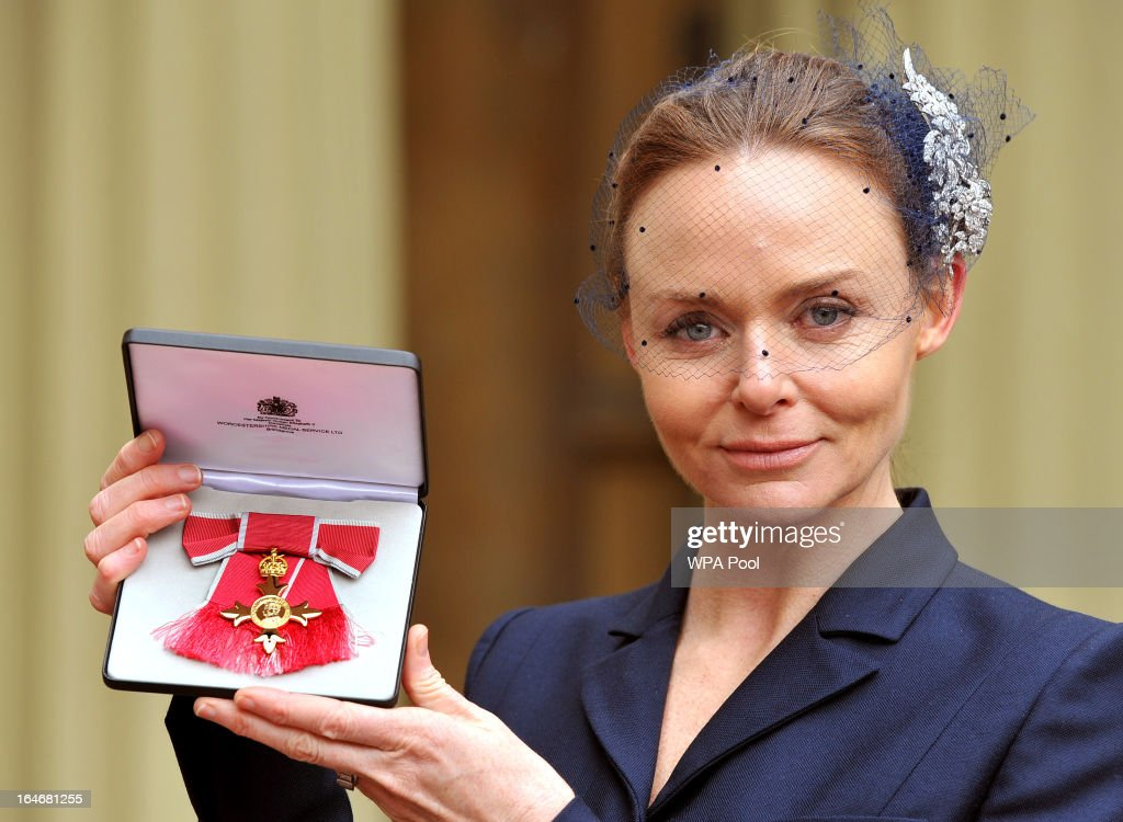 Fashion designer Stella McCartney holds her Officer of the British Empire (OBE) award after the Investiture Ceremon at Buckingham Palace on March 26, 2013 in London, England.