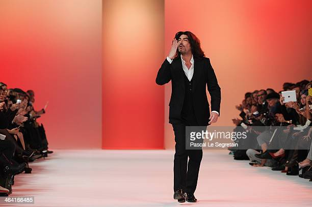 Fashion designer Stephane Rolland acknowledges the applause of the audience after his show as part of Paris Fashion Week Haute Couture Spring/Summer...