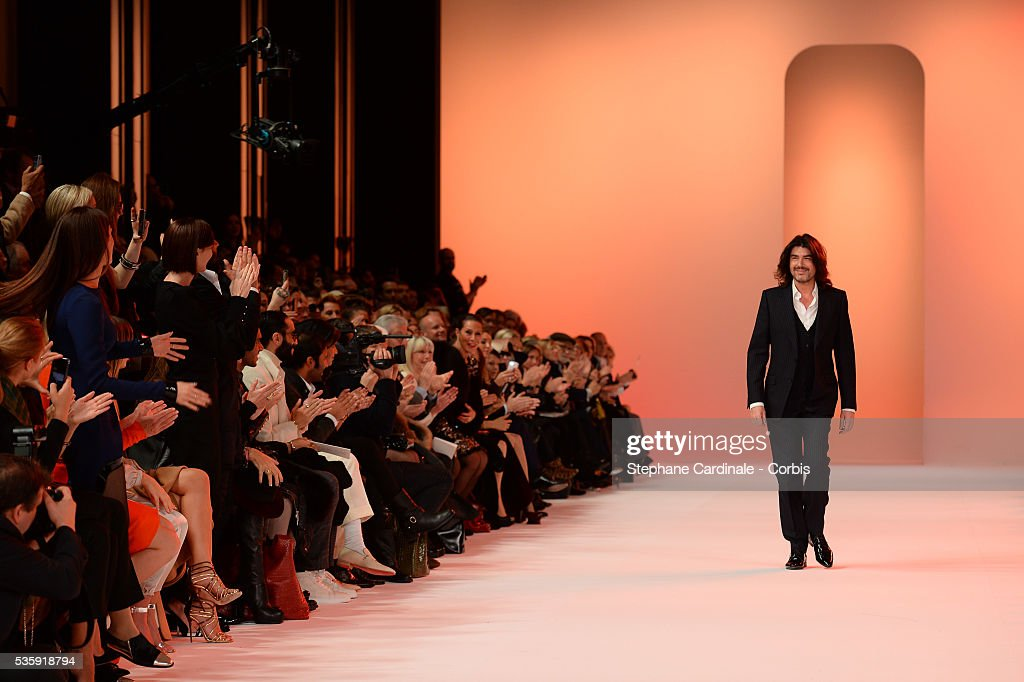 Fashion designer Stephane Rolland acknowledges the applause of the audience after his show as part of Paris Fashion Week Haute-Couture Spring/Summer 2014, at Grand Palais in Paris.