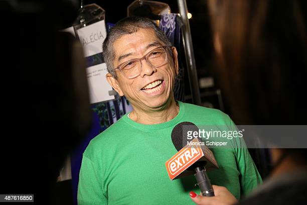 Fashion designer Tadashi Shoji prepares backstage at the Tadashi Shoji fashion show during Spring 2016 New York Fashion Week at The Dock Skylight at...