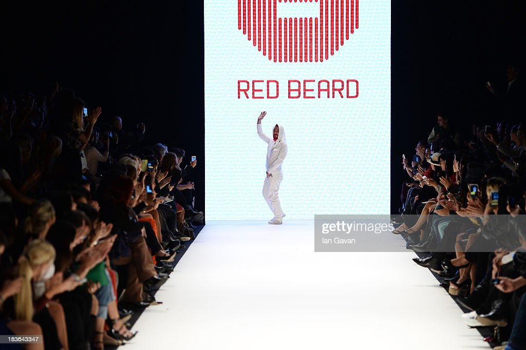 Fashion designer Tanju Babacan walks the runway at the Red Beard By Tanju Babacan show during Mercedes-Benz Fashion Week Istanbul s/s 2014 presented by American Express on October 8, 2013 in Istanbul, Turkey.
