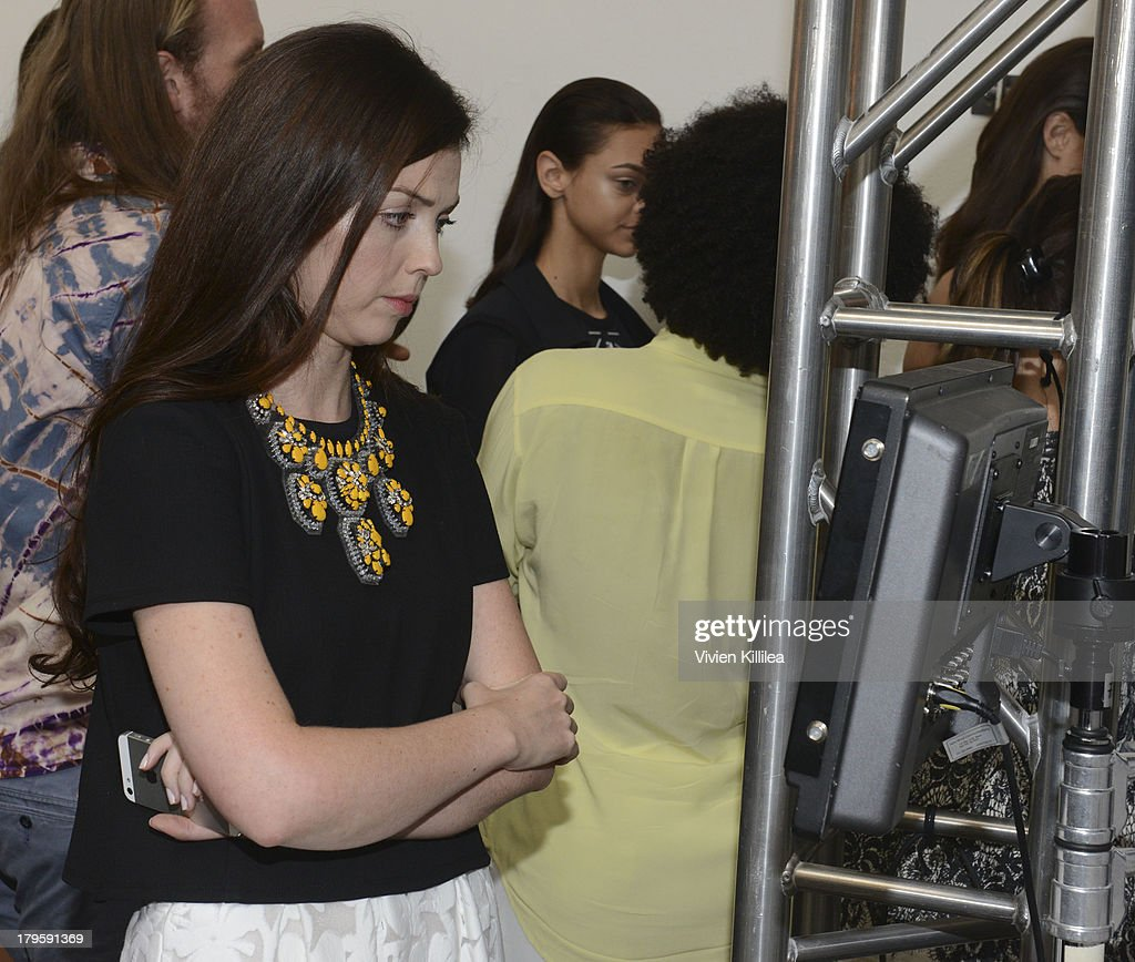 Fashion designer Tanya Taylor watches the show backstage at the Tanya Taylor fashion show during Mercedes-Benz Fashion Week Spring 2014 at Industria Studios on September 5, 2013 in New York City.