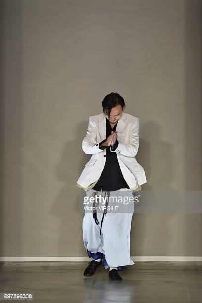 Fashion designer Teppei Fujita walks the runway at the Sulvam fashion show during Milan Men's Fashion Week Spring/Summer 2018 on June 18 2017 in...