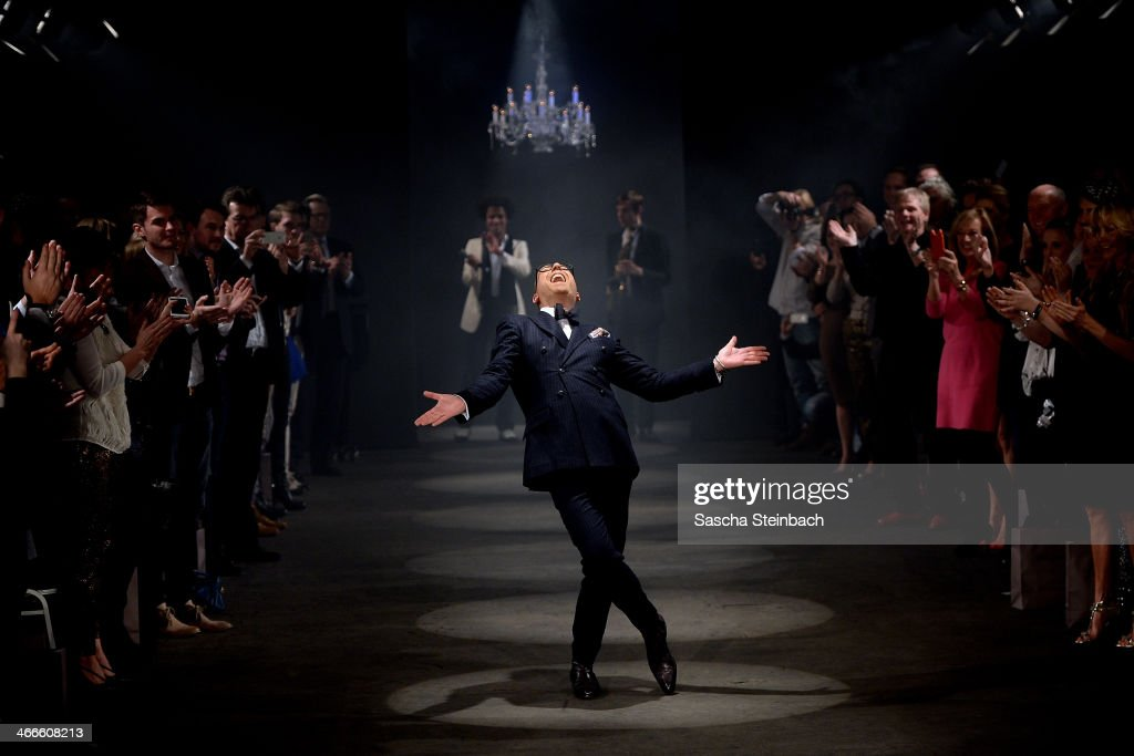 Fashion designer Thomas Rath celebrates his show during Platform Fashion Dusseldorf on February 2, 2014 in Dusseldorf, Germany.