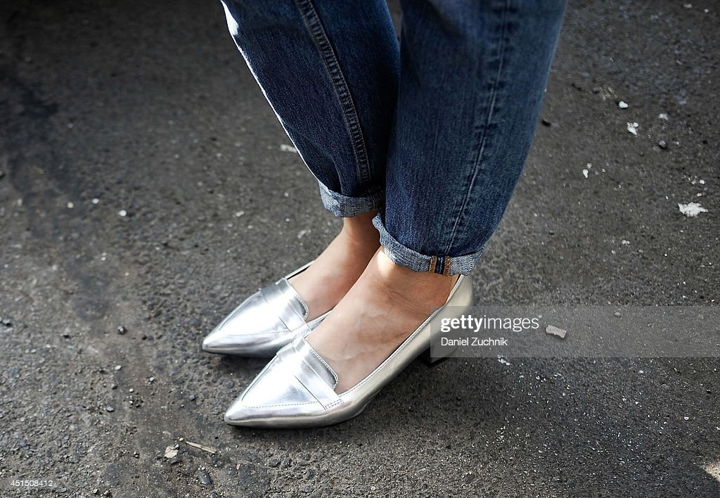 Fashion Designer Ting is seen around Nolita wearing SOS shoes on June 30 2014 in New York City