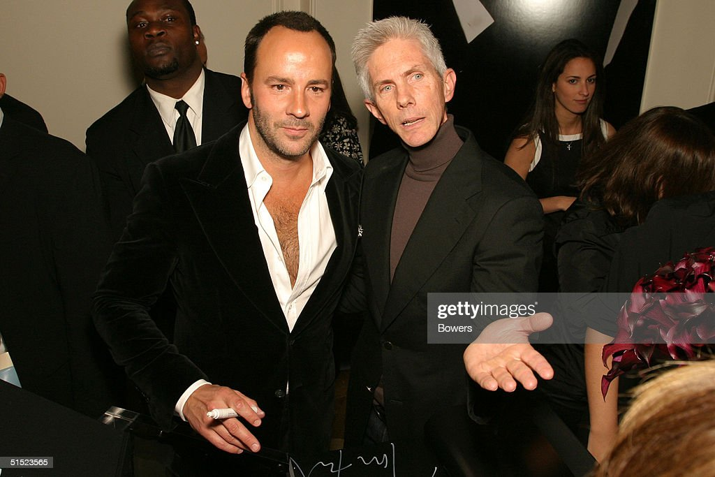 Fashion designer Tom Ford and partner journalist Richard Buckley at the book launch party for 'Tom Ford:Ten Years' at Bergdorf Goodman October 20, 2004 in New York City. (Photo by Bowers/Getty Images).