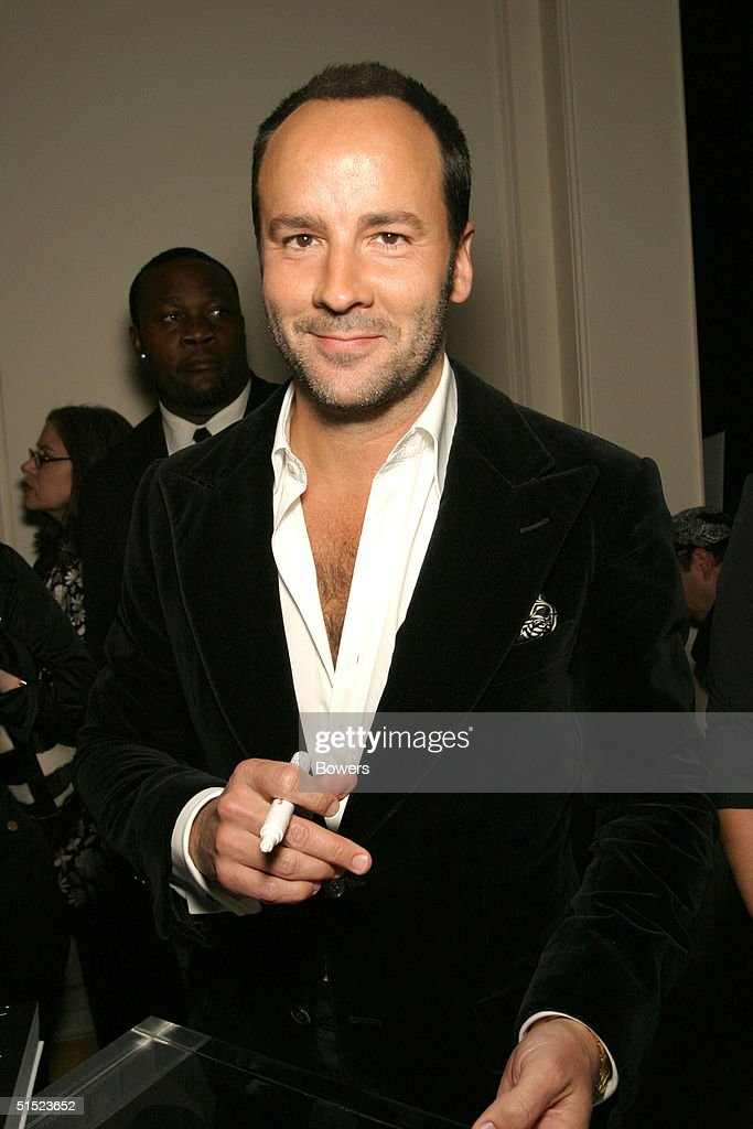 Fashion designer Tom Ford signs a copy of his book 'Tom Ford:Ten Years' at his book launch party at Bergdorf Goodman October 20, 2004 in New York City.