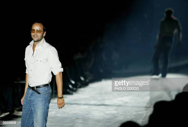 US fashion designer Tom Ford walks on the catwalk at the end of the Gucci collection during the Milan's 2004 Spring/Summer fashion week 02 October...