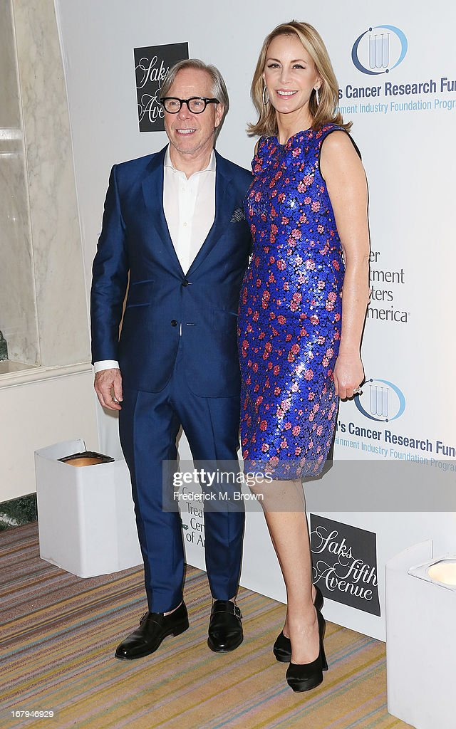 Fashion designer Tommy Hilfiger (L) and Dee Hilfiger attend the EIF Women's Cancer Research Fund's 16th Annual 'An Unforgettable Evening' presented by Saks Fifth Avenue at the Beverly Wilshire Four Seasons Hotel on May 2, 2013 in Beverly Hills, California.