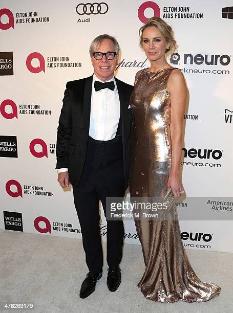 Fashion designer Tommy Hilfiger and Dee Ocleppo attend the 22nd Annual Elton John AIDS Foundation's Oscar Viewing Party on March 2 2014 in Los...