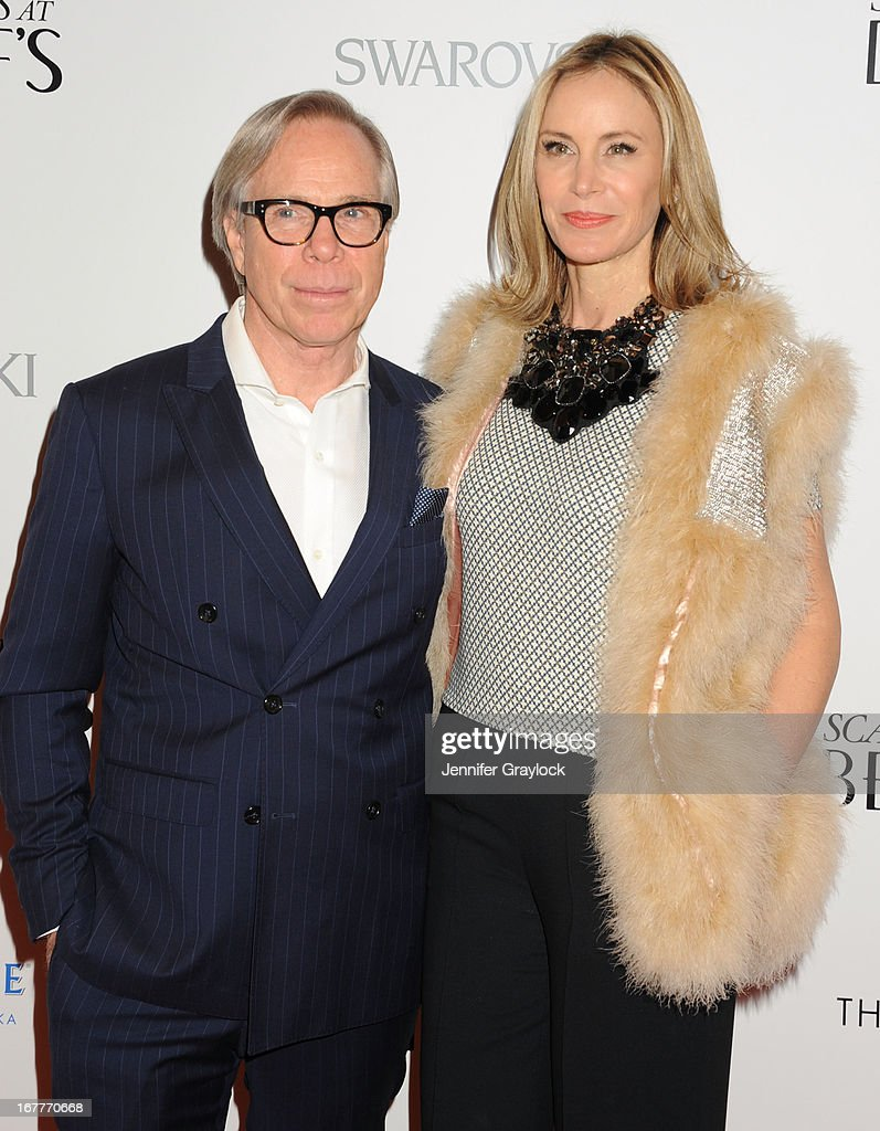 Fashion designer Tommy Hilfiger and Dee Ocleppo attend the Cinema Society with Swarovski & Grey Goose premiere of eOne Entertainment's 'Scatter My Ashes at Bergdorf's'at Florence Gould Hall on April 29, 2013 in New York City.