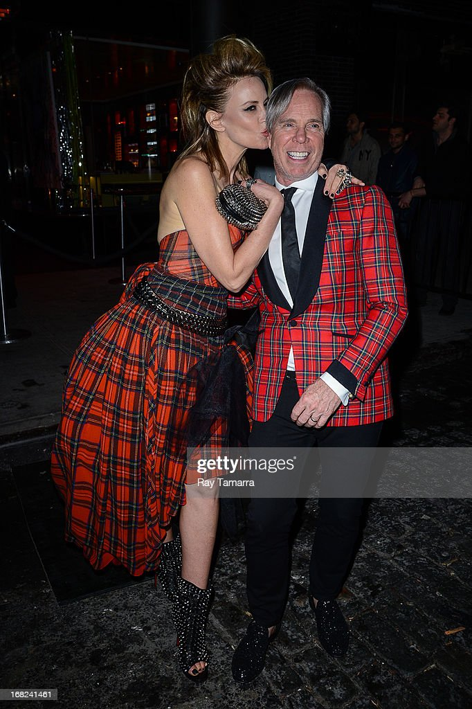Fashion designer Tommy Hilfiger (R) and Dee Ocleppo Hilfiger leave the 'PUNK: Chaos To Couture' Costume Institute Gala after party at the Standard Hotel on May 6, 2013 in New York City.