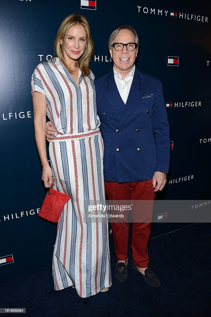 Fashion designer Tommy Hilfiger (R) and his wife Dee Hilfiger arrive at the Tommy Hilfiger West Coast Flagship Grand Opening Event at Tommy Hilfiger West Hollywood on February 13, 2013 in West Hollywood, California.