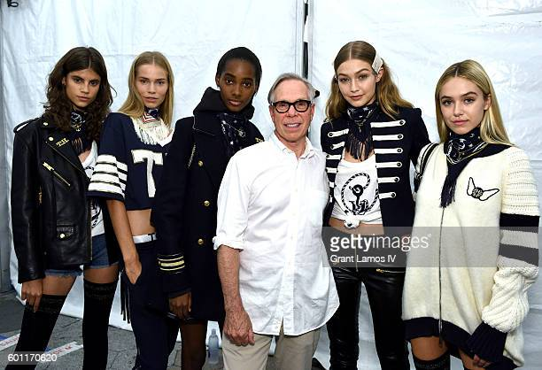 Fashion designer Tommy Hilfiger and model Gigi Hadid pose with models backstage at the #TOMMYNOW Women's Fashion Show during New York Fashion Week at...