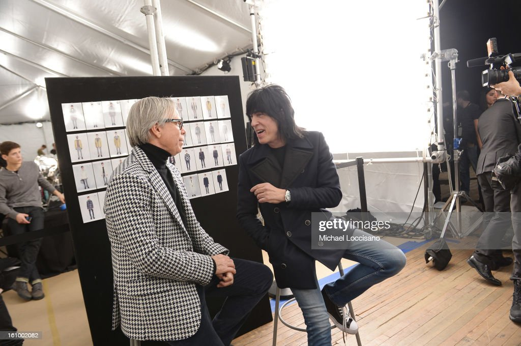 Fashion designer Tommy Hilfiger (L) and musician Marky Ramone prepare backstage at the Tommy Hilfiger Men's Fall 2013 fashion show during Mercedes-Benz Fashion Week at Park Avenue Armory on February 8, 2013 in New York City.