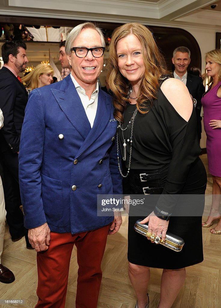 Fashion designer Tommy Hilfiger (L) and Pam Bergman attend Tommy Hilfiger New West Coast Flagship Opening on Robertson Boulevard on February 13, 2013 in West Hollywood, California.