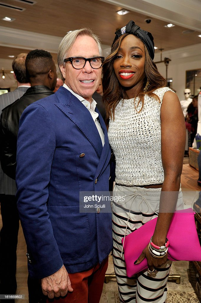 Fashion designer Tommy Hilfiger and singer Estelle attend Tommy Hilfiger New West Coast Flagship Opening on Robertson Boulevard on February 13, 2013 in West Hollywood, California.