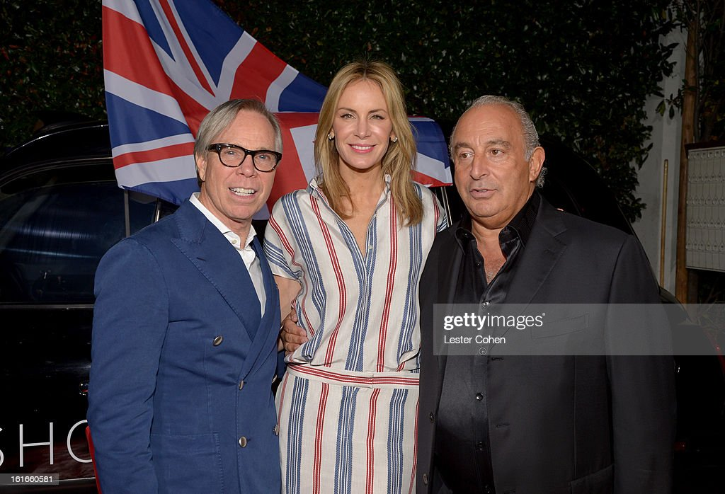 Fashion designer Tommy Hilfiger, Dee Hilfiger and Sir Philip Green arrive at the Topshop Topman LA Opening Party at Cecconi's West Hollywood on February 13, 2013 in Los Angeles, California.