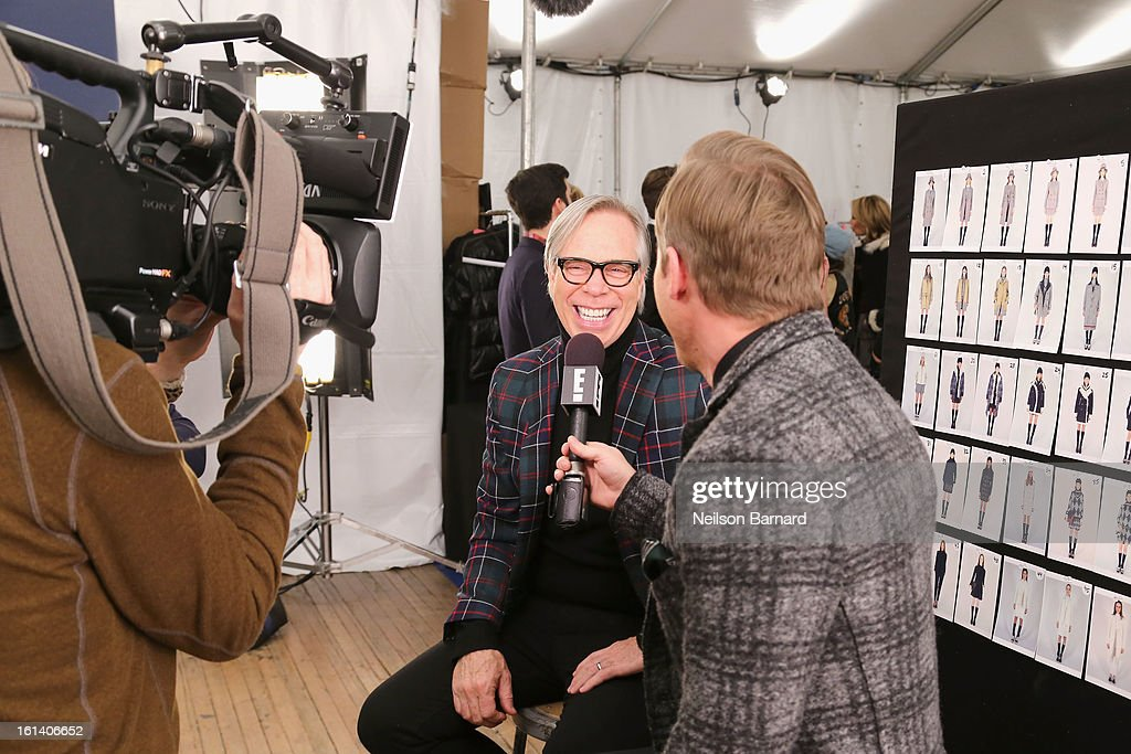 Fashion designer Tommy Hilfiger is interviewed backstage at the Tommy Hilfiger Fall 2013 Women's Collection fashion show during Mercedes-Benz Fashion Week at the Park Avenue Armory on February 10, 2013 in New York City.