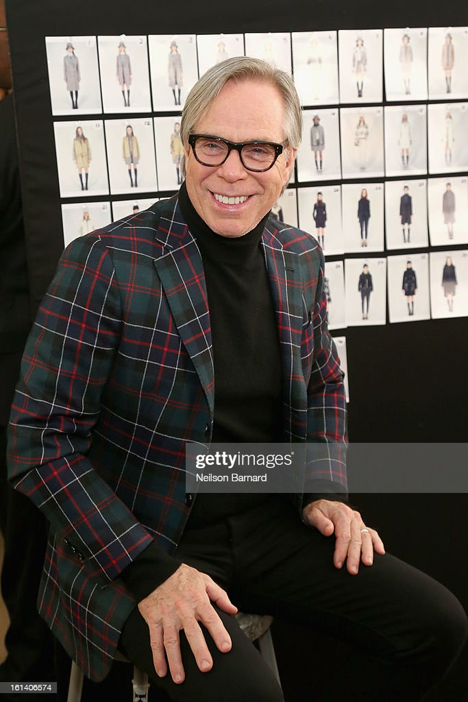 Fashion designer Tommy Hilfiger poses backstage at the Tommy Hilfiger Fall 2013 Women's Collection fashion show during Mercedes-Benz Fashion Week at the Park Avenue Armory on February 10, 2013 in New York City.