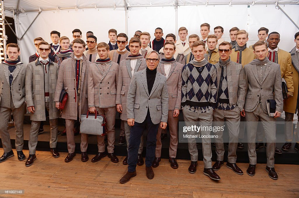 Fashion designer Tommy Hilfiger (C) poses with models backstage at the Tommy Hilfiger Men's Fall 2013 fashion show during Mercedes-Benz Fashion Week at Park Avenue Armory on February 8, 2013 in New York City.