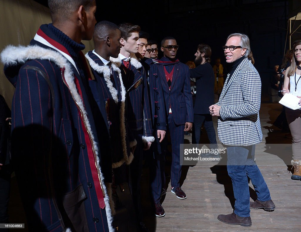 Fashion designer Tommy Hilfiger prepares backstage at the Tommy Hilfiger Men's Fall 2013 fashion show during Mercedes-Benz Fashion Week at Park Avenue Armory on February 8, 2013 in New York City.
