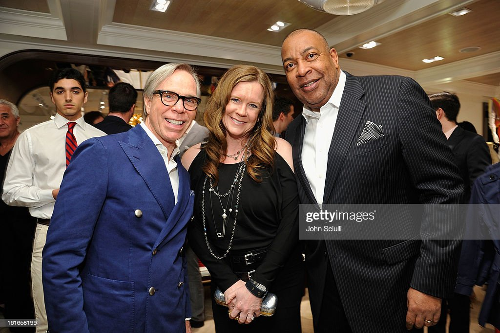 Fashion designer Tommy Hilfiger, PS Arts Chairman Pam Bergman and Guy Vickers, President, Corporate Foundation at Tommy Hilfiger attend Tommy Hilfiger New West Coast Flagship Opening on Robertson Boulevard on February 13, 2013 in West Hollywood, California.