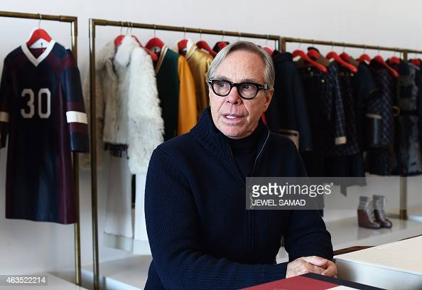 US fashion designer Tommy Hilfiger speaks during an interview with Agence FrancePresse on February 15 2015 in New York a day before his show at the...