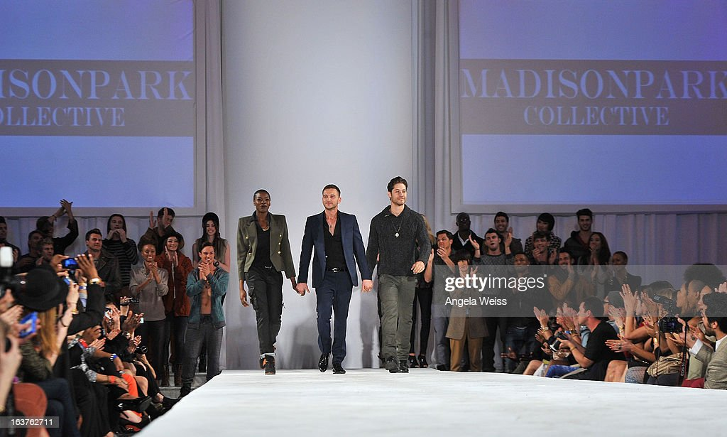 Fashion designer Trey Alligood (C) with models acknowledges the audience during the Madisonpark Collective 2013 fashion show as part of Los Angeles Fashion Week at Vibiana on March 14, 2013 in Los Angeles, California.
