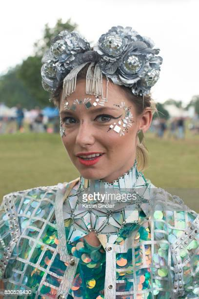 Fashion Designer Twinks Burnett wears a Twinks Burnett head piece Wolf and Moon earrings Jane Bowler necklace and jacket Rosa Bloom top and a Louise...