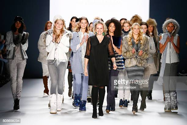 Fashion designer Ulli Ehrlich acknowleges the applause of the audience at the end of the Sportalm show during the MercedesBenz Fashion Week Berlin...