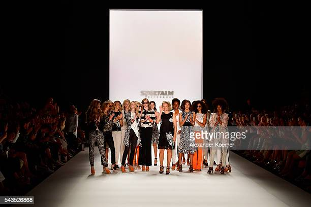 Fashion designer Ulli Ehrlich acknowleges the applause of the audience at the Sportalm show during the MercedesBenz Fashion Week Berlin Spring/Summer...