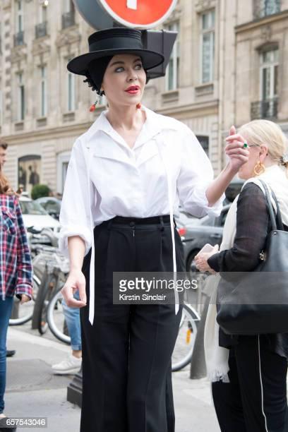 Fashion designer Ulyana Sergeenko wears a Chanel blouse Dolce Gabbana trousers and Stephen Jones hat day 2 of Paris Haute Couture Fashion Week...