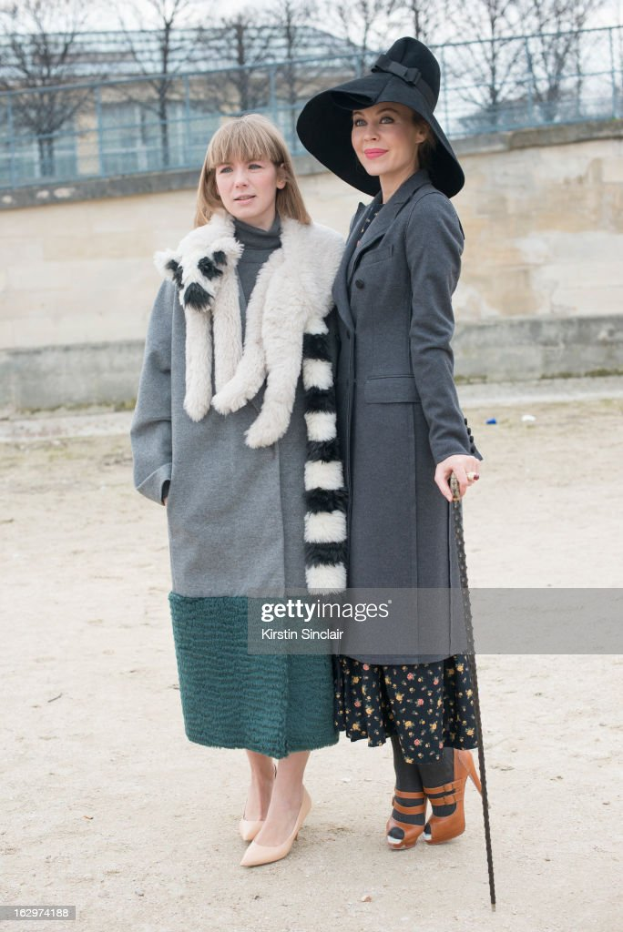 Fashion designer Vika Gazinskaya wears her own design, with fasion designer and photographer Ulyana Serjeenko wearing a Dolce and Gabbana coat, a hat from Russia, Christian Louboutin shoes and her own design dress on day 2 of Paris Womens Fashion Week Autumn/Winter 2013 on March 1, 2013 in Paris, France.