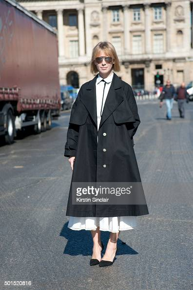 Fashion Designer Vika Gazinskaya wears Zara shoes Rayban sunglasses and a Vika Gasinskaya skirt shirt and jacket on day 8 during Paris Fashion Week...