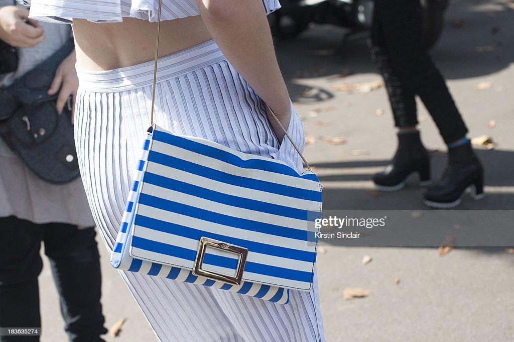 Fashion designer Vika Gazinskya wearing her own design top and trousers, Roger Vivier bag on day 9 of Paris Fashion Week Spring/Summer 2014, Paris October 02, 2013 in Paris, France.