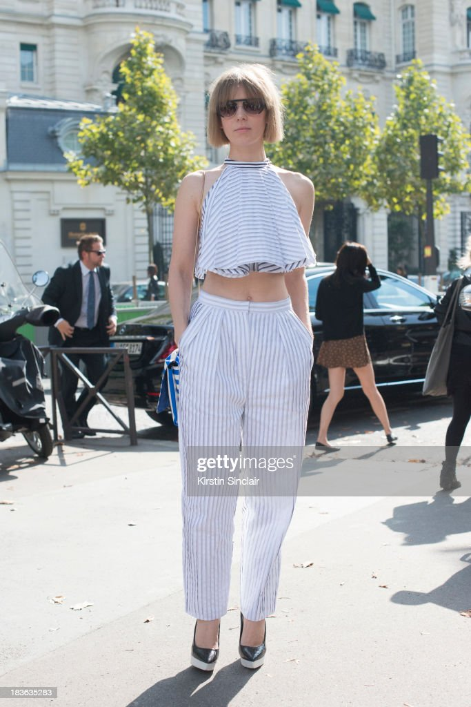 Fashion designer Vika Gazinskya wearing her own design top and trousers, Roger Vivier bag, Stella McCartney shoes and And Other Stories sunglasses on day 9 of Paris Fashion Week Spring/Summer 2014, Paris October 02, 2013 in Paris, France.