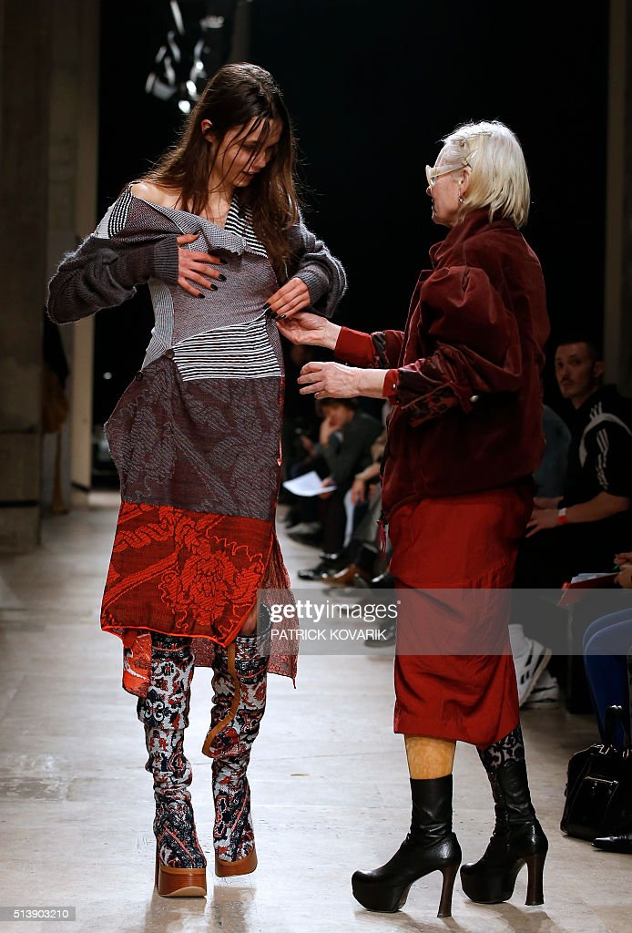 Fashion designer Vivienne Westwood adjusts an outfit on a model during the Vivienne Westwood 20162017 fall/winter readytowear collection on March 5...