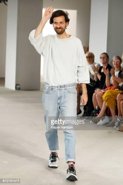 Fashion designer Vladimir Karaleev acknowledges the applause of the audience at the Vladimir Karaleev show during the MercedesBenz Fashion Week...