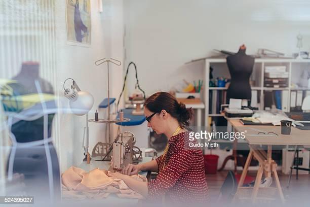 Fashion designer working in studio.
