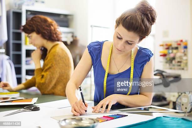 Fashion designer working on new dress design