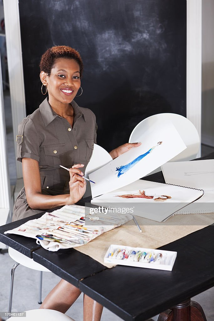 Fashion designer working on sketches : Stock Photo