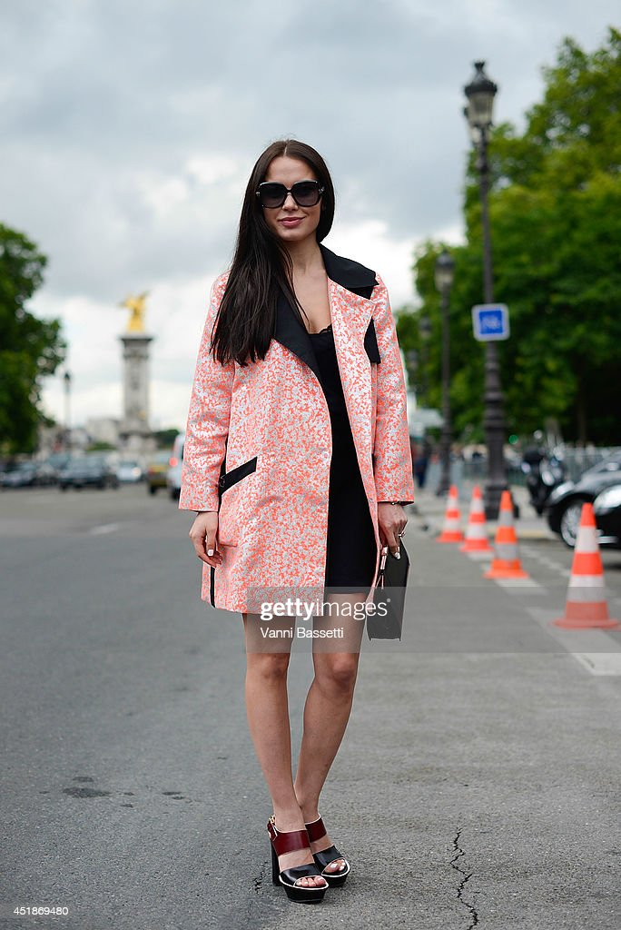 Fashion designer Yasya Minochkina poses wearing Yasya Minochkina dress and coat, Marni shoes and Dior bag after Chanel show on July 8, 2014 in Paris, France.