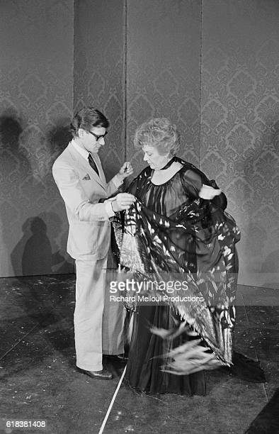 Fashion designer Yves Saint Laurent fits a costume to actress Edwige Feuillere for an upcoming production of Dear Liar The play going under the title...