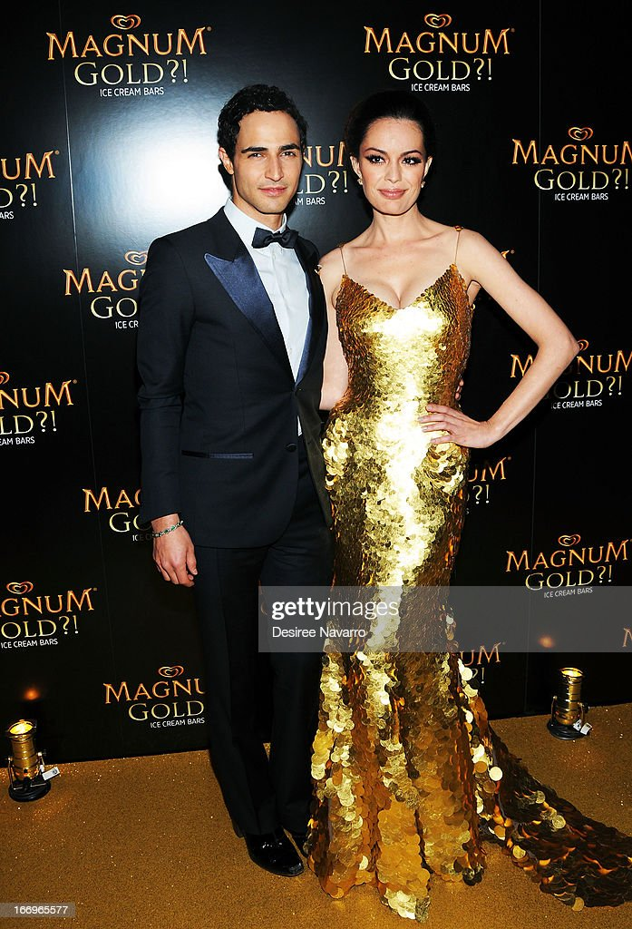 Fashion designer Zac Posen and actress Caroline Correa (wearing Zac Posen's one of a kind 24k gold dress) attend the screening of 'As Good As Gold' during the 2013 Tribeca Film Festival at Gotham Hall on April 18, 2013 in New York City.