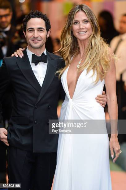 Fashion designer Zac Posen and model and television personality Heidi Klum enter the CFDA Fashion Awards at Hammerstein Ballroom on June 5 2017 in...