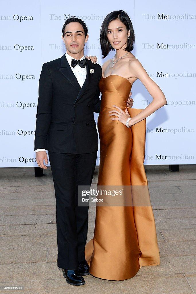 Fashion designer Zac Posen and model Tao Okamoto attend the Metropolitan Opera Season Opening at The Metropolitan Opera House on September 22 2014 in...