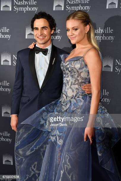 Fashion Designer Zac Posen and recording artist Kelsea Ballerini arrive at Schermerhorn Symphony Center on April 18 2017 in Nashville Tennessee