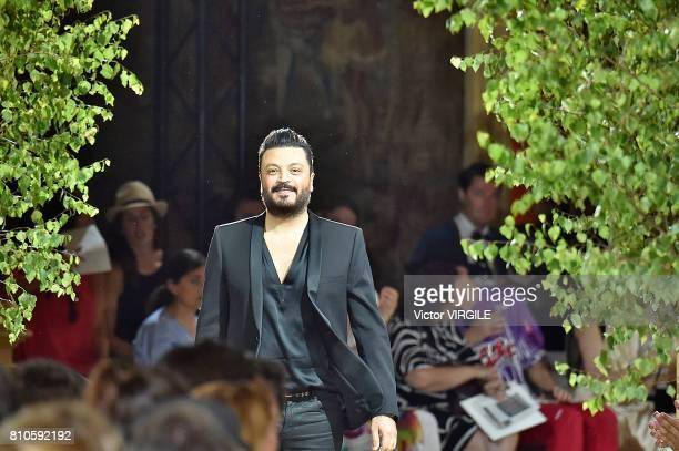 Fashion designer Zuhair Murad walks the runway during the Zuhair Murad Haute Couture Fall/Winter 20172018 show as part of Haute Couture Paris Fashion...